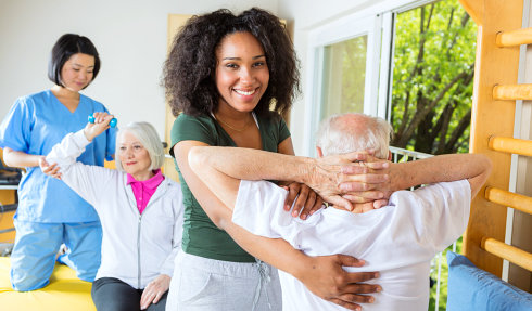 caregivers performing physical therapy