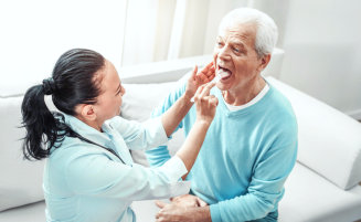 professional checking patient's tongue