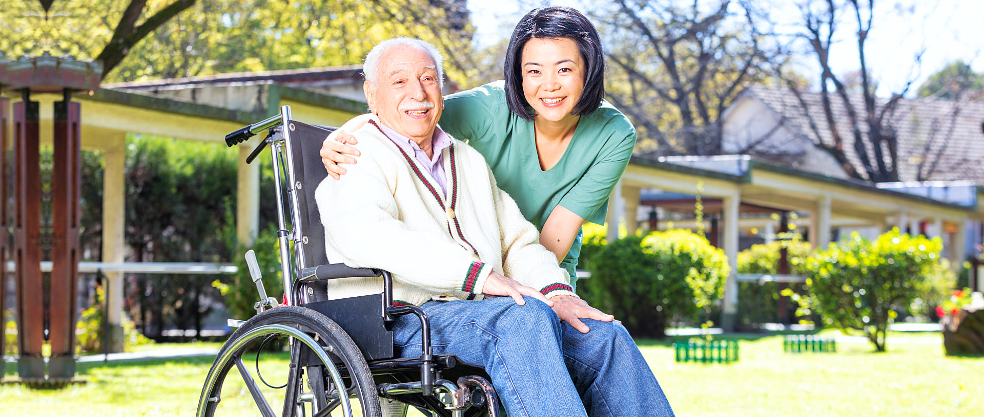 caregiver with her senior patient in wheelchair