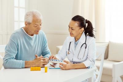 Nurse prescribing medicines to the elder man